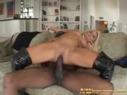 Blonde girl rides a black cock