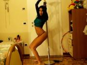 Sexy latina girl in thong dancing at the pole