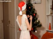 Pretty teen showing hot slim body on the sofa near the Christmas tree on stream on video.