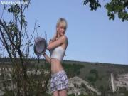 Online video of perfect blonde teen girl in hat undressing and spreading legs in the field.