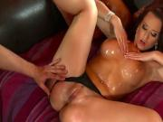 Hot brunette makes room for an oily titfuck