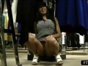 Brunette amateur dares to rub her pussy in a clothing store