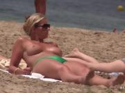 Stunning Milf with big tits on topless beach
