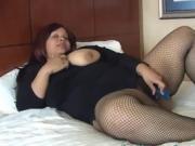 Fat Babe In Black Fishnet Stockings Masturbating