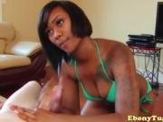 An ebony beauty gives a long white dick a hand job