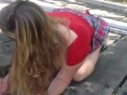Pretty Girl In Red In Park Sucks His Waiting Cock