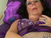 Older Woman Masturbating With Purple Dildo