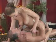 Shaved cunt brunette rides masseur
