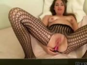 Tan and naked spit on her beautiful tits and stick toy in as