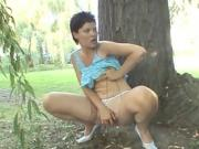 Brunette Woman Plays With Her Vagina By A Tree