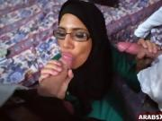 Arab babe with glasses sucks two cocks for money