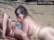Spying public blow jobs at nude beach