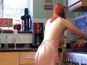 redhead white shaved pussy wears nothing but the apron at home