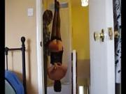 Naomi dangling upside down and whipped