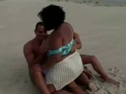 BBW fucks two guys on a beach...