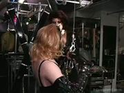 Domme Binds Her Female Sub