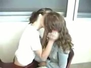 Two cute teens kissing at school