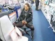 Cute milf pisses in the middle of a store