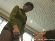 Mistress tortures her slave by pressing her heels on his body