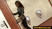 Brunette plays with cum at the gloryhole