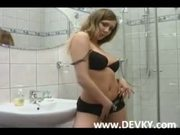 Busty girl rubbing the botton in a shower