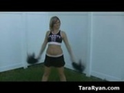 Cute babe in cheerleader outfit reveals tits and ass