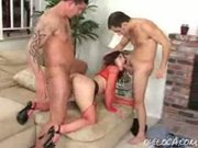 hot Rene Pornero in red fishnets gets fucked from behind while sucking another cock