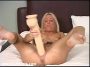 French Canadian blonde fucking a big brutal dildo