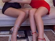Hot lesbian fucking on sofa