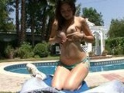 petite brunette Kandi sucking cock by the pool