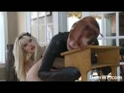 Bound redhead in leather straight jacket spanked by mistress