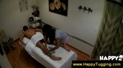 Masseuse slides hand under a towel