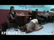 Leashed brunette spanked in restaurant
