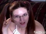 Hot girl with glasses giving a handjob