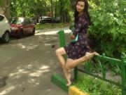 Amateur girl in sexy dress likes walking barefoot and showing her hot feet in public