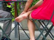 Foot showoff during relaxing lunch