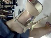 Dangling T Strap heels while shopping