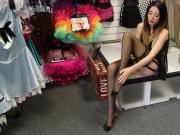 Exotic girl in sexy black stockings trying on some sexy shoes on her feet