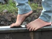 Very dirty feet walking on railing