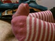 Striped cotton socks make a soft and warm footjob