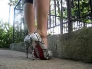 Walking in Louboutin snake skin pumps