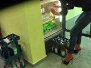 Stiletto clad employee loading fridge