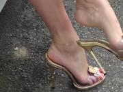Toe showoff dangling gold sandals