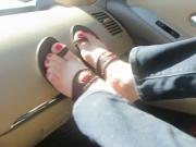 Changing shoes in the car and putting feet on dashboard