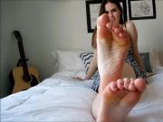 Adorable Young Lady Sits On Her Bed and Wiggles Around Her Cute Little Toes