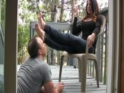 Feet worshipping slave out on deck