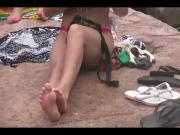 Teen in bikini showing off pedicured toes