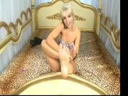 Hot tattooed girl worships her delicious feet in front of the camera