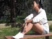 Slim Ponytailed cutie gets socks dirty in public
