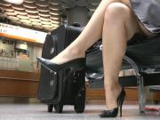 Airport black heel showoff in skirt